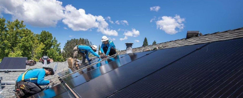 solar team working on roof panels